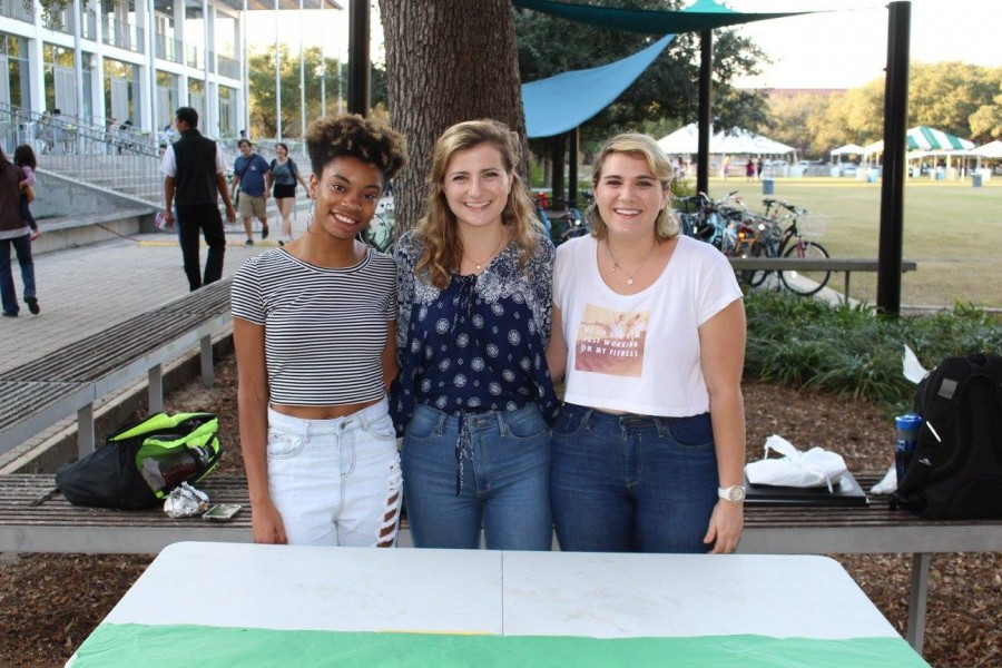 Co-producers of this year's Hers, Theirs, Ours performance (from left) Jae Nichelle, Eliza Kauffman and Corley Miller pose at a tabling event promoting the show.