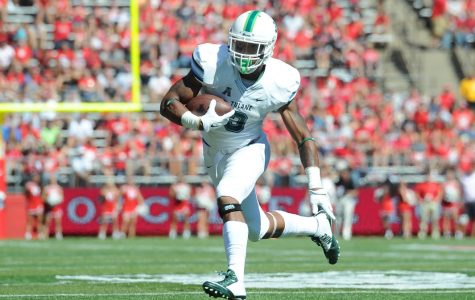 Freshman running back Sherman Badie runs the ball in a 31-6 loss against Rutgers in Piscataway, New Jersey. Badie averages 89 rushing yards per game, on 7.2 yards per carry.