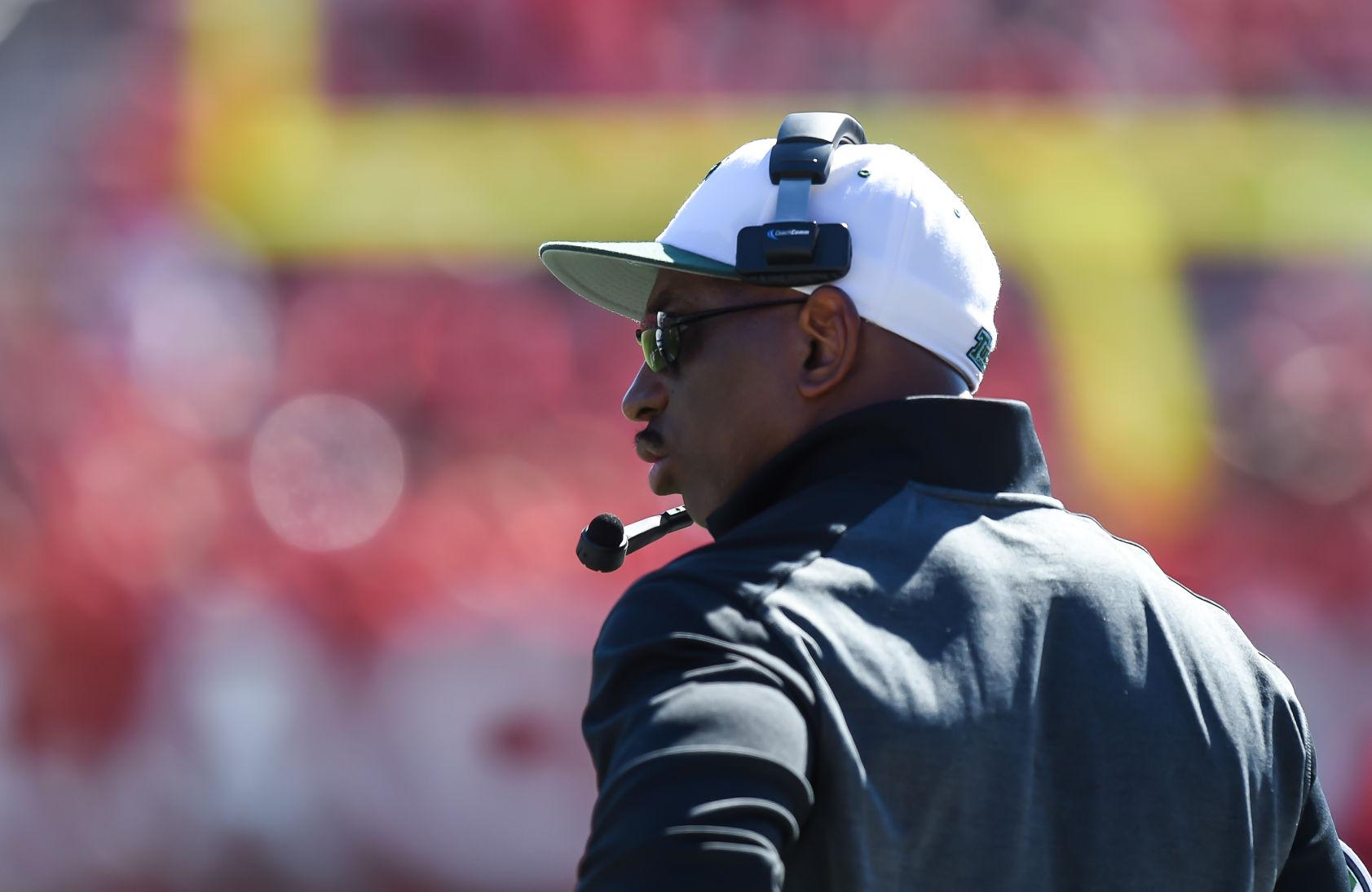 Football head coach Curtis Johnson pacing the sidelines in the 31-6 loss against Rutgers Sept. 27, in Piscataway, New Jersey. Johnson consistently wears the black sunglass, flat-rim hat look each game.