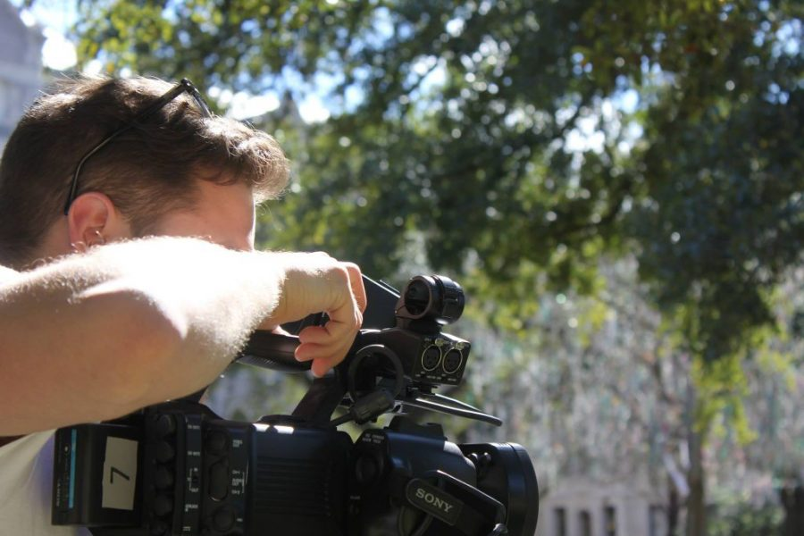 Senior Brandon Kaplan is in the process of filming a movie for his capstone in Digital Media Production on the Academic Quad.