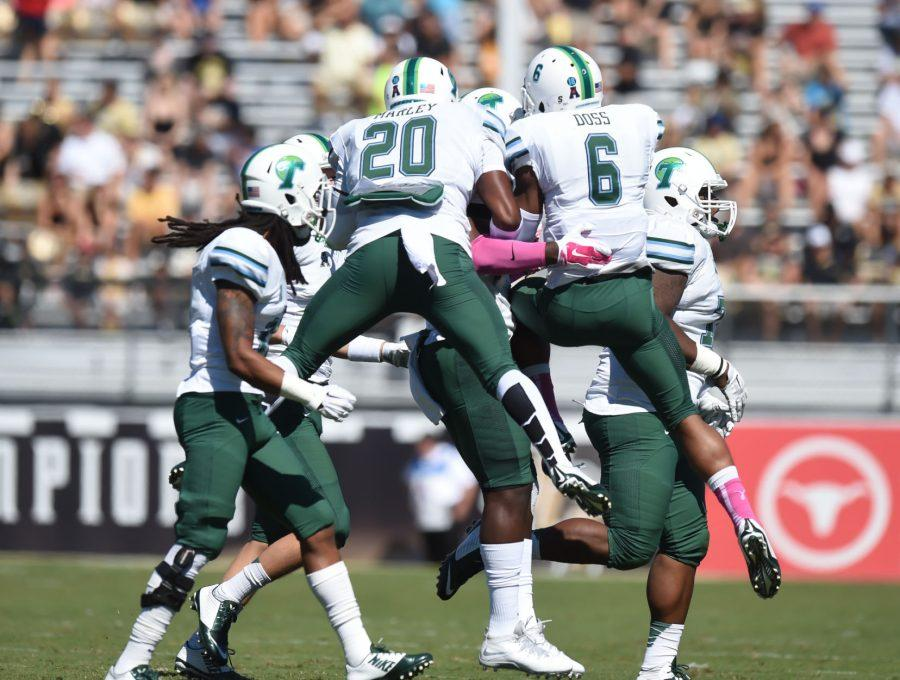 Sophomore linebacker Nico Marley and junior cornerback Lorenzo Doss celebrate a defensive stop in a 20-13 loss against Central Florida Saturday, Oct. 18.Doss was selected in the fifth round of the 2015 NFL Draft by the Denver Broncos. Doss dialed up 15 interceptions in his three-year collegiate career with the Green Wave.