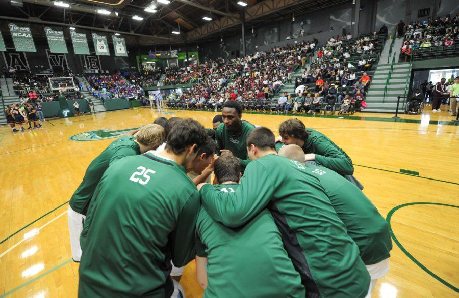 Tulane men's basketball huddles before the exhibition game against Loyola.Counting the two graduating seniors in guard Jay Hook and forward Tre Drye, eight players are leaving head coach Ed Conroy's program.