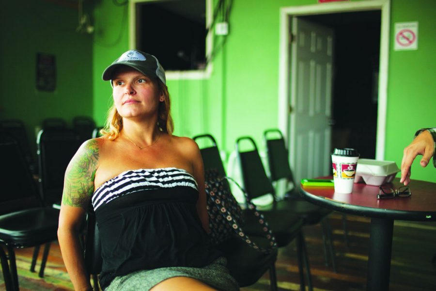 La Nuit Comedy Theater manager Kelly Stone poses at the club Tuesday. Landry hopes La Nuit will be a humor hub for Uptown.