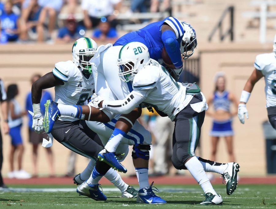 Nico Marley makes a tackle in last seasons 47-13 loss to Duke on Sept. 20, 2014. Marley was placed on the Rotary Lombardi award watch list in 2015.