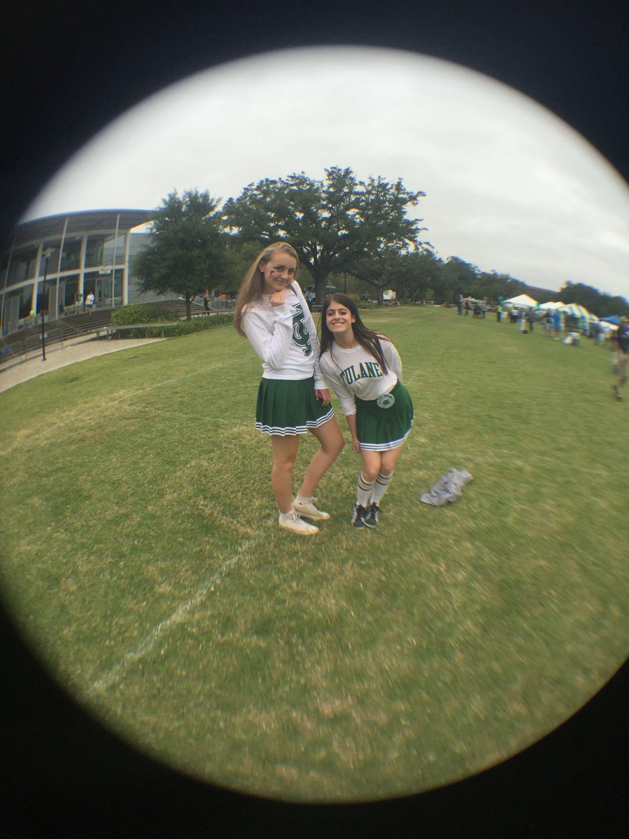 Tulane students sophomore Hannah Myers and sophomore Lauren Breitstone dress in Tulane cheerleading skirts for Houston tailgate Oct. 17.