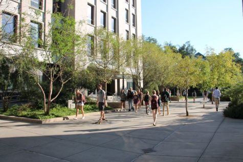 Students walk past Lindy Boggs Center for Energy and Biotechnology. Boggs houses some of Tulane's science and engineering departments, which have some of the largest gender disparities in their professorship.