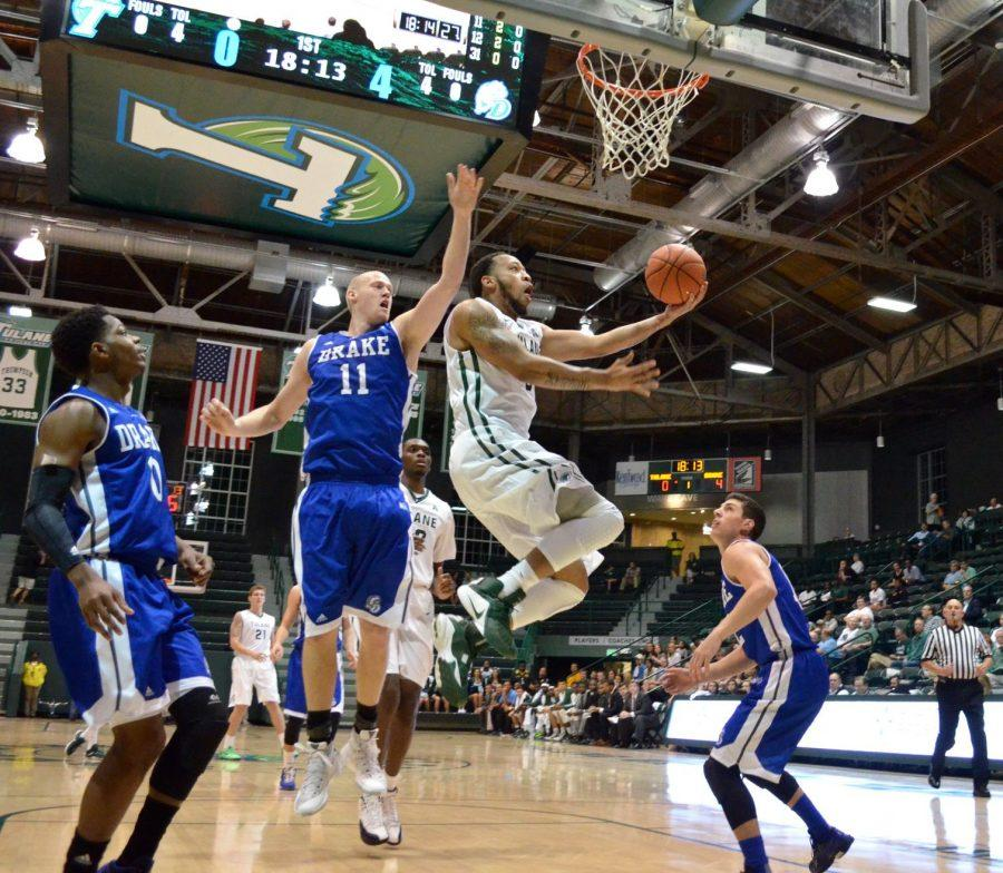 Senior+guard+Louis+Dabney+lays+in+two+points+during+the+Wave%27s+79-74+win+against+the+Drake+Bulldogs.+Dabney%2C+the+team%27s+leading+scorer%2C+finished+the+overtime+contest+with+18+points+and+five+rebounds.%C2%A0