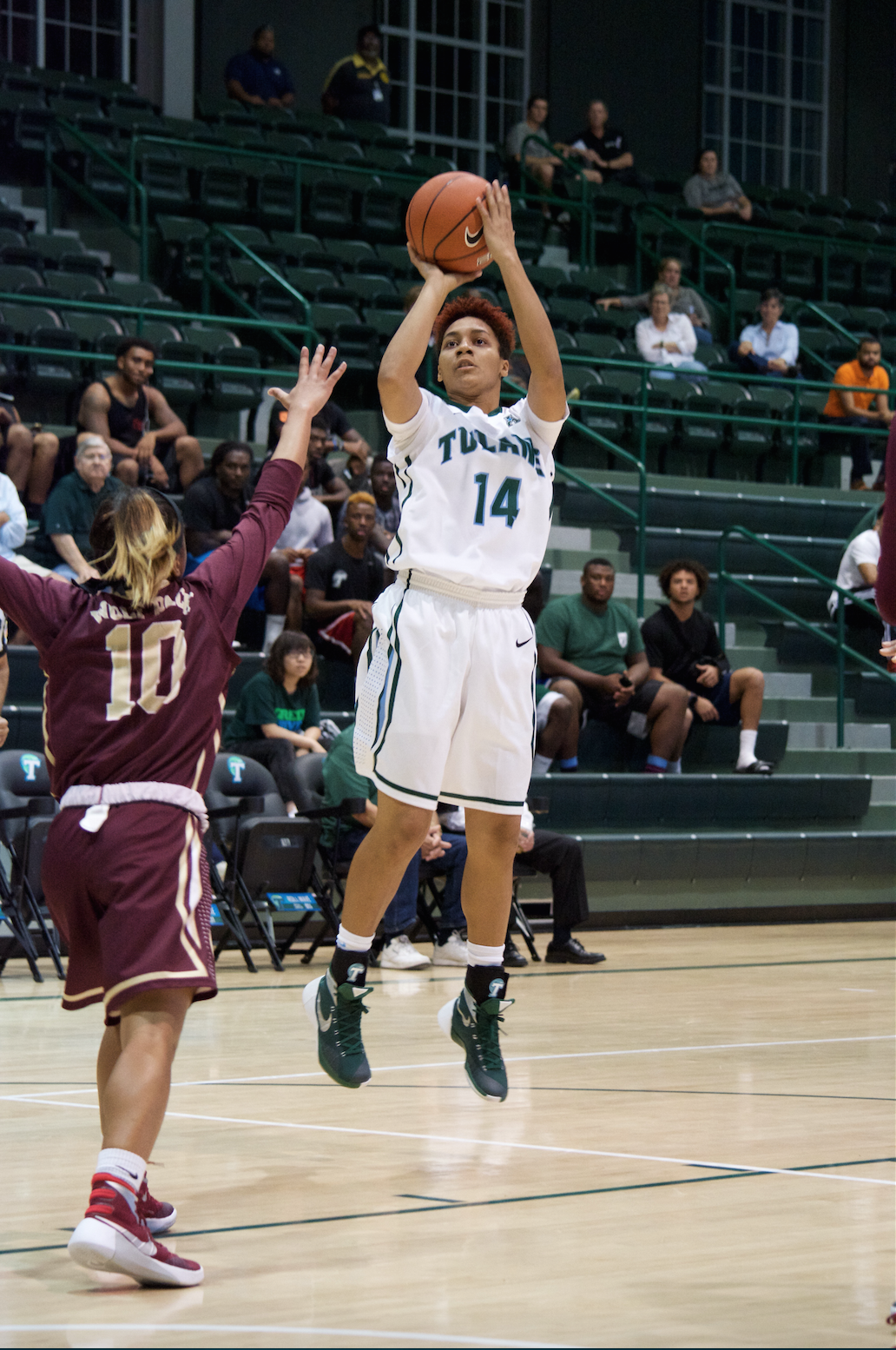 Freshman guard Taylor Emery shoots over sophomore guard Zoie Miller for a two pointer to contribute to Tulane's win in her first Green Wave appearance against Loyola New Orleans on Nov 5 in Devlin Fieldhouse.