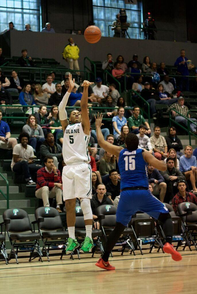 Redshirt sophomore Cameron Reynolds elevates for a shot during Tulane's 94-87 overtime win against Memphis on Sunday. The Pearland, Texas native finished the day with 12 points.