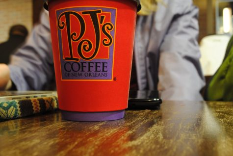 USG and PJ's Coffee have partnered to distribute 52,000 coffee sleeves listing resources for sexual assault survivors.