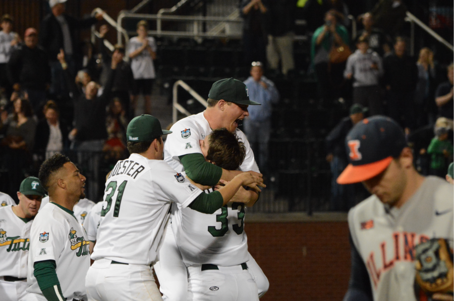 Redshirt junior catcher Jeremy Montalbano, senior pitcher Patrick Deuster and other members of the Tulane baseball team celebrate the three-run walk-off home run hit by Montalbano. Tulane defeated Illinois in the tenth inning (6-5) on Feb. 19 in Turchin Stadium.
