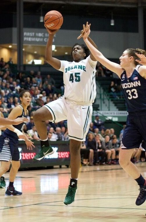 Chinwe Duru drives to the hoop in the Green Waves 96-38 loss to the UConn Huskies on February 3. The 62 senior has averaged 7.3 points and 4.4 rebounds per game this season.