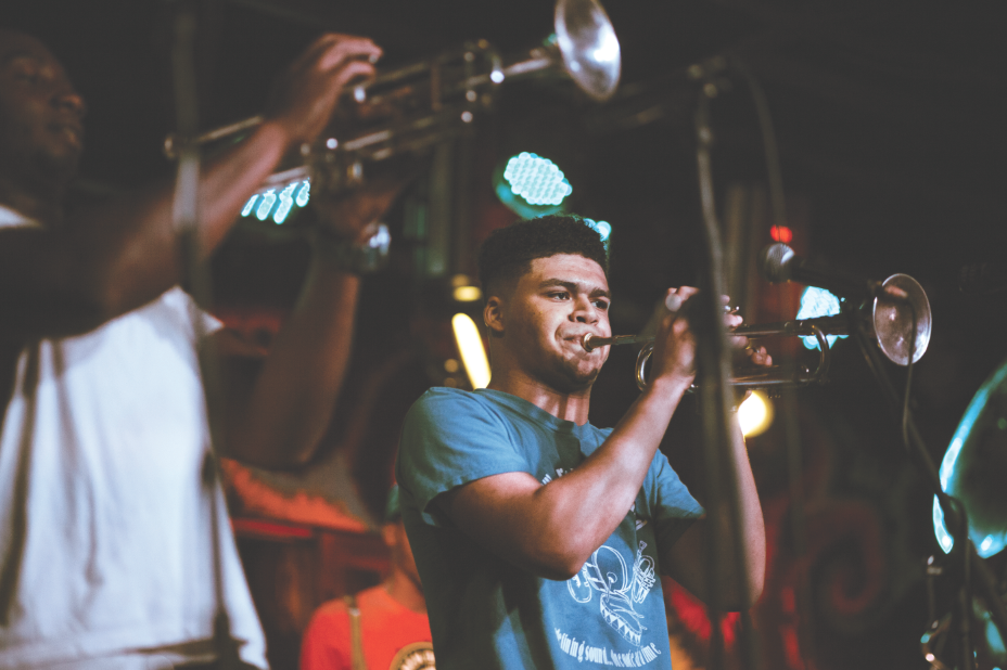 Junior Aurélien Barnes performs as the youngest member of New Breed Brass Band for the group's weekly gig at Blue Nile on Frenchmen Street.