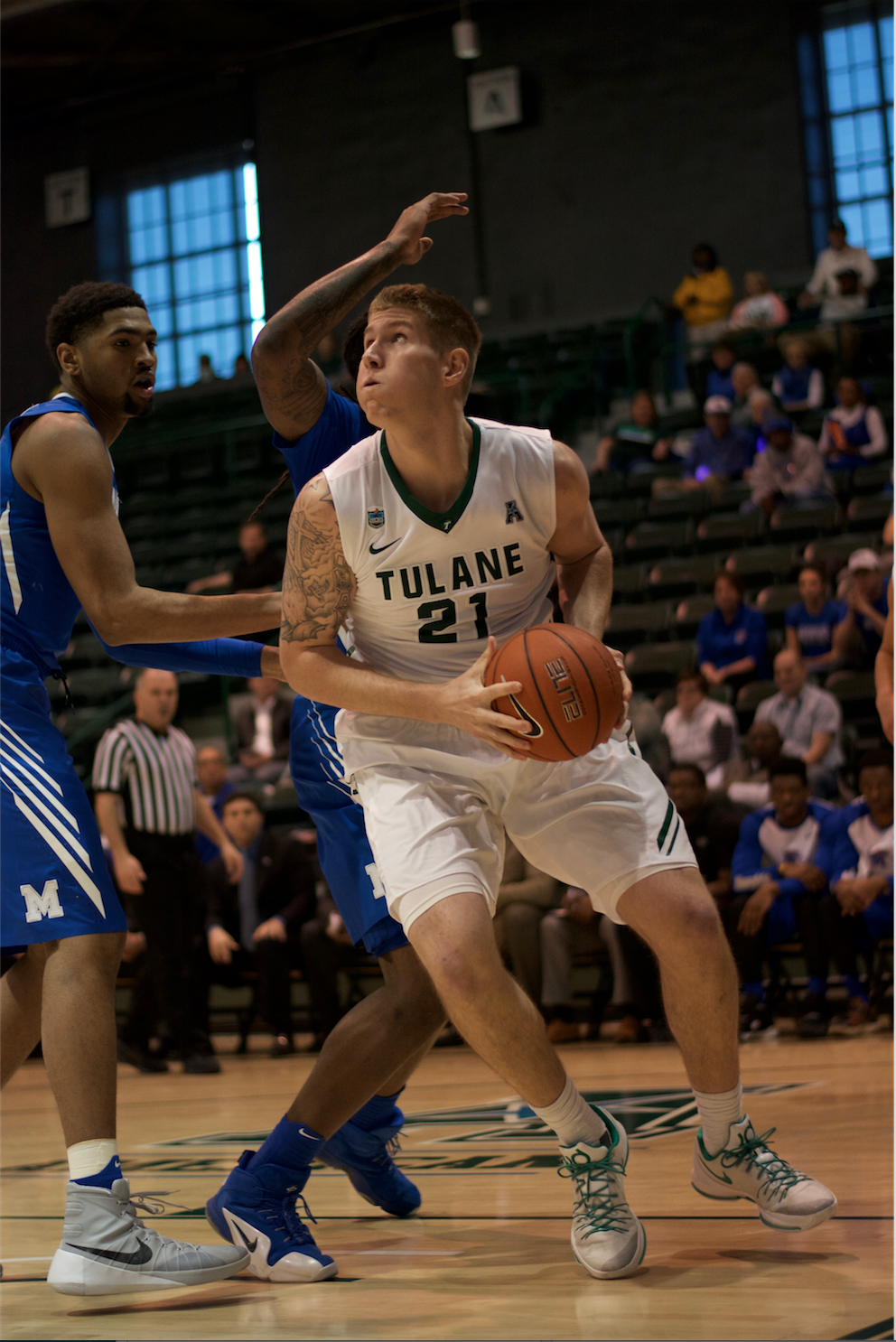 Sophomore forward Dylan Osetkowski makes a move on the basket to score two points in Tulane's 94-87 overtime win against Memphis on Feb. 13 in Devlin Fieldhouse.