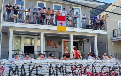 Kappa Alpha Fraternity members at Tulane University constructed a wall out of sandbags that read