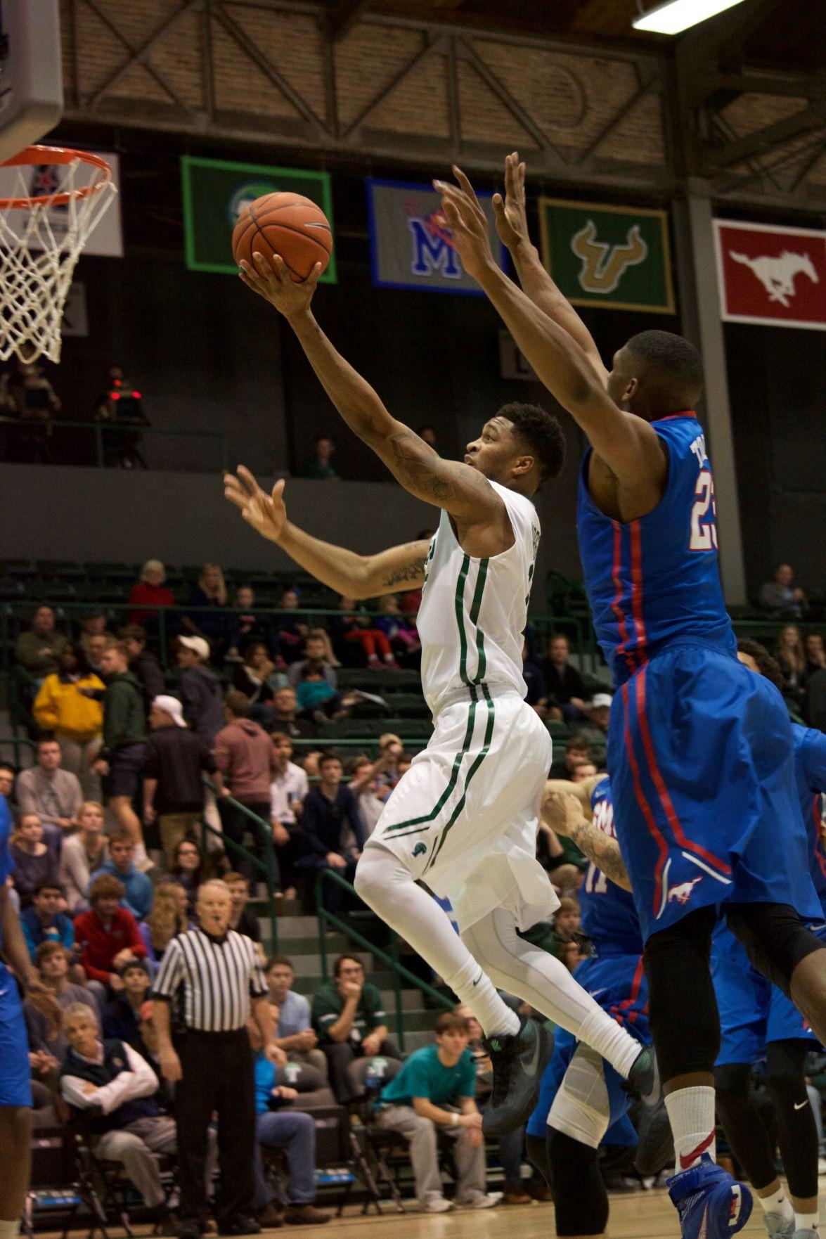 Redshirt junior guard Malik Morgan goes up for a lay up against a Southern Methodist University Mustang in a 60-45 loss this past season.