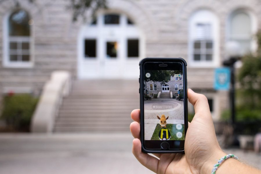 A+pokemon+appears+in+front+of+Gibson+Hall.+The+app+integrates+the+virtual+with+the+real+world+environment+to+create+an+immersive+experience.