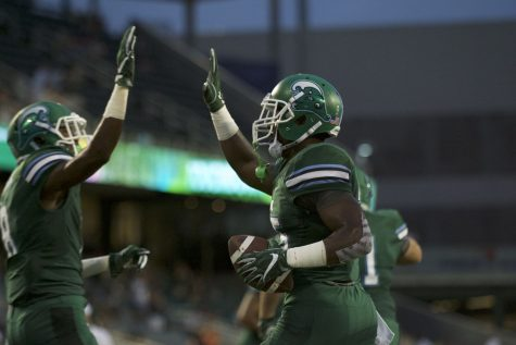 Junior running back DontrellHilliardcelebrates after scoring a touchdown for the Green Wave. Tulane is currently 0-1 (AAC).