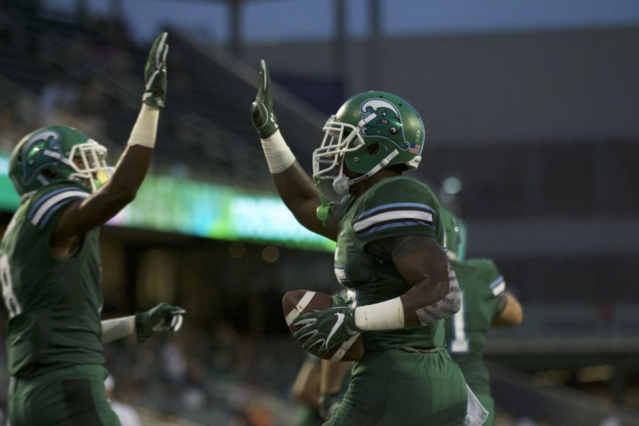 Junior running back Dontrell Hilliard celebrates after scoring a touchdown for the Green Wave. Tulane is currently 0-1 (AAC).