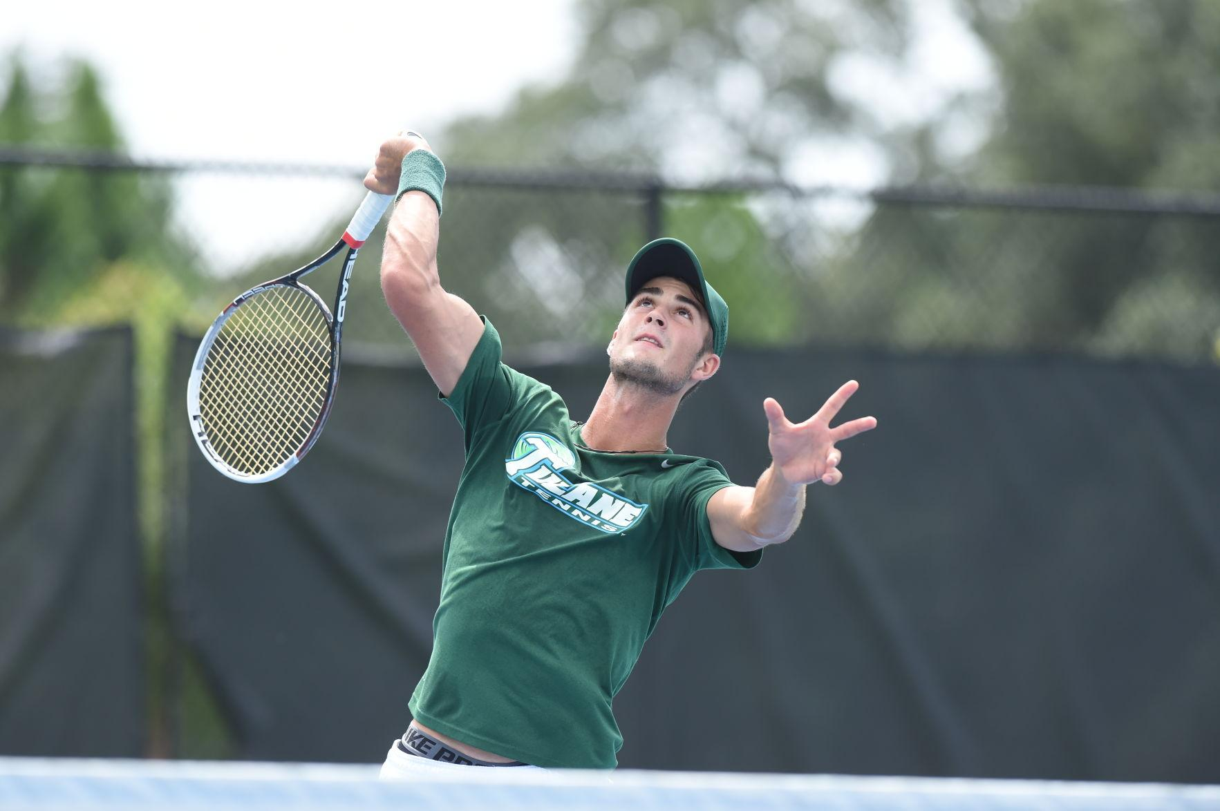 Junior Constantin Schmitz serves a ball. Schmitz produced the most dual victories for men's tennis in the 2015-2016 season, with a 19-3 record.