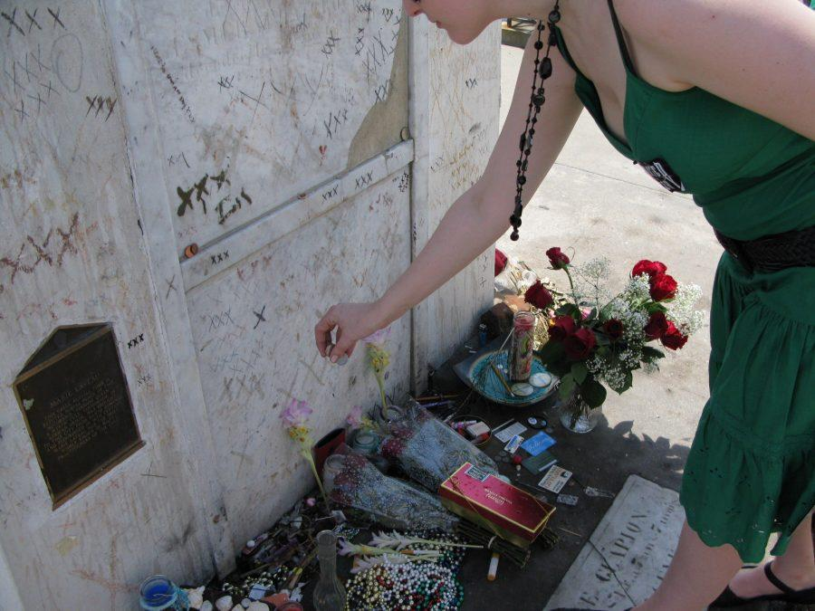 A+visitor+pays+homage+to+Marie+Laveau+at+her+tomb+in+St.+Louis+No.+1+Cemetery.