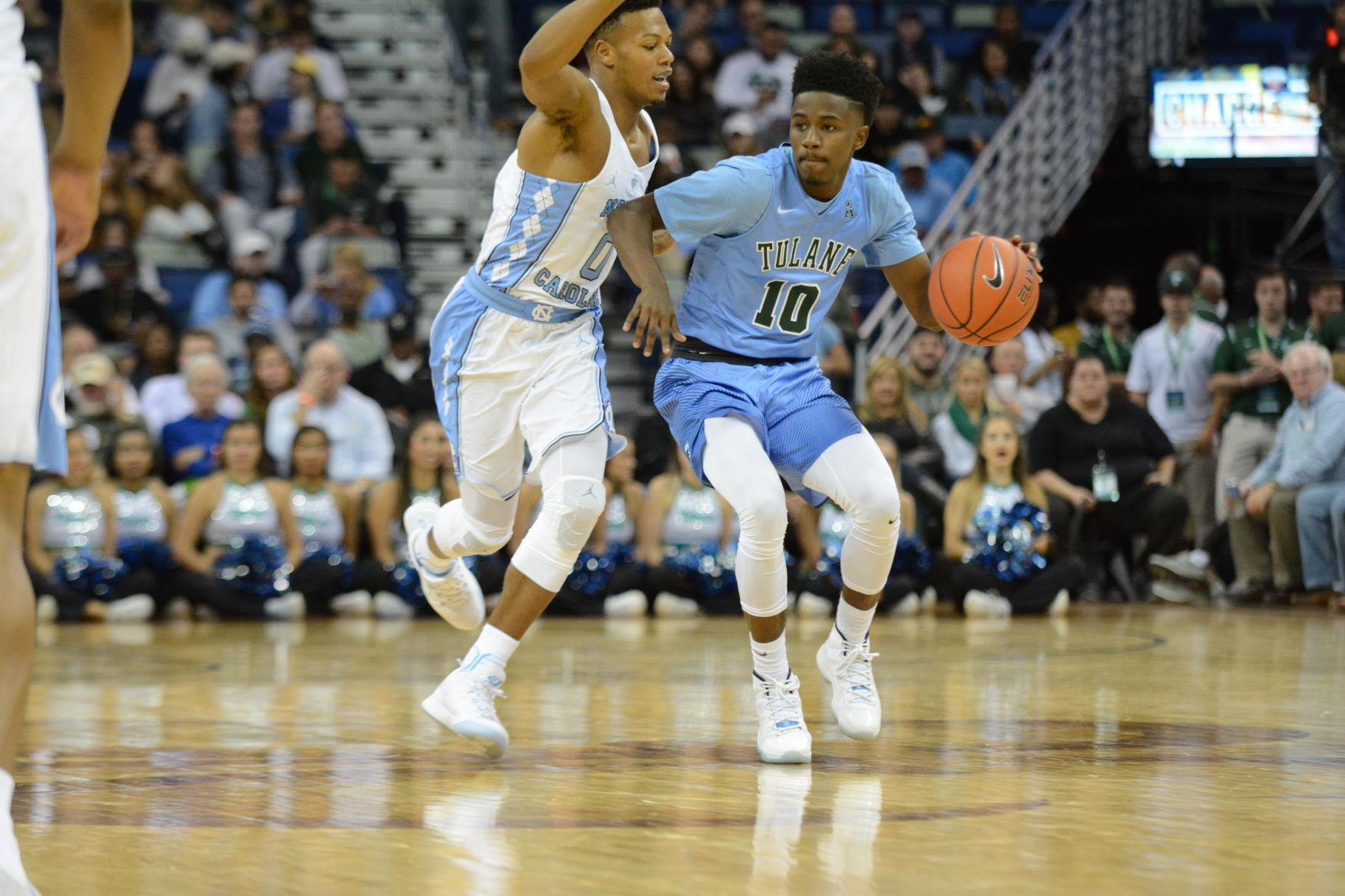 Sophomore guard Von Julien dribbles around a UNC defender as the teams clashed on Nov. 11 in the Smoothie King Center.