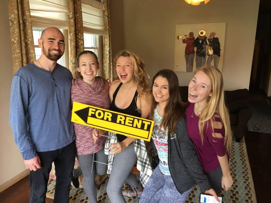 Kallin Zehren, Amy Kane, Kylie Shadle and Gabrielle Gardiner pose in their new house after the fire that destroyed their previous home.