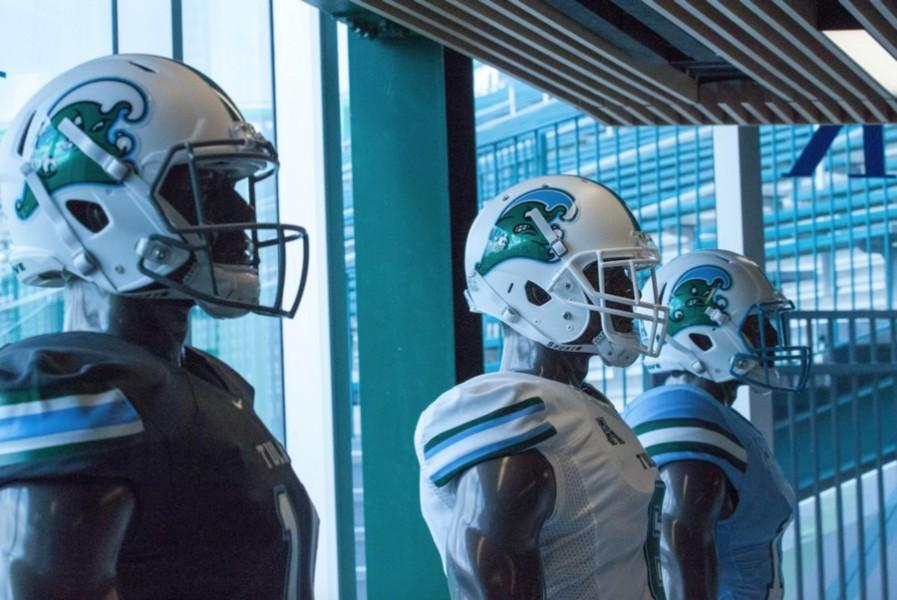 With+the+revived+Angry+Wave+featured+on+the+side%2C+Tulane+football+is+one+of+several+teams+that+redesigned+its+uniforms+this+year.+The+new+uniforms+were+created+to+reflect+the+past%2C+present+and+future+of+Tulane+and+New+Orleans.