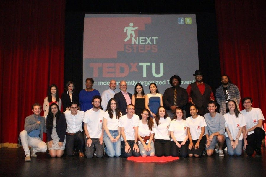 Speakers+and+organizers+pose+on+stage+at+the+TedxTU+event+Monday+in+Dixon+Hall.The+event+featured+speakers+from+a+variety+of+professions+and+backgrounds.