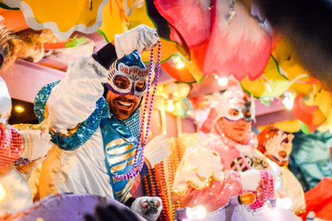 Patrons on floats like those above toss throws to parade attendants. The Krewe of Orpheus is one of the parades this weekend that students form their traditions around.