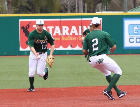 Senior infielderJake Willsey readies a pass to freshman outfielder Kobi Owen during a practice before their opening weekend. Willsey started all three games for the Wave, finishing with one hit and two stolen bases overall.