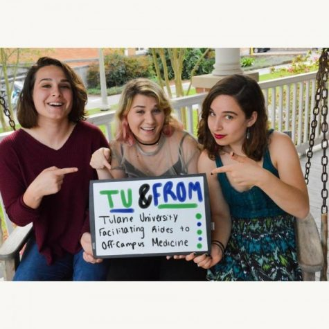(From left to right) Eva Dils, Corley Miller and Sarah Levison pose with a sign advertising the TU and FROM campaign. The program aims to increase access to off-campus health care providers for students.
