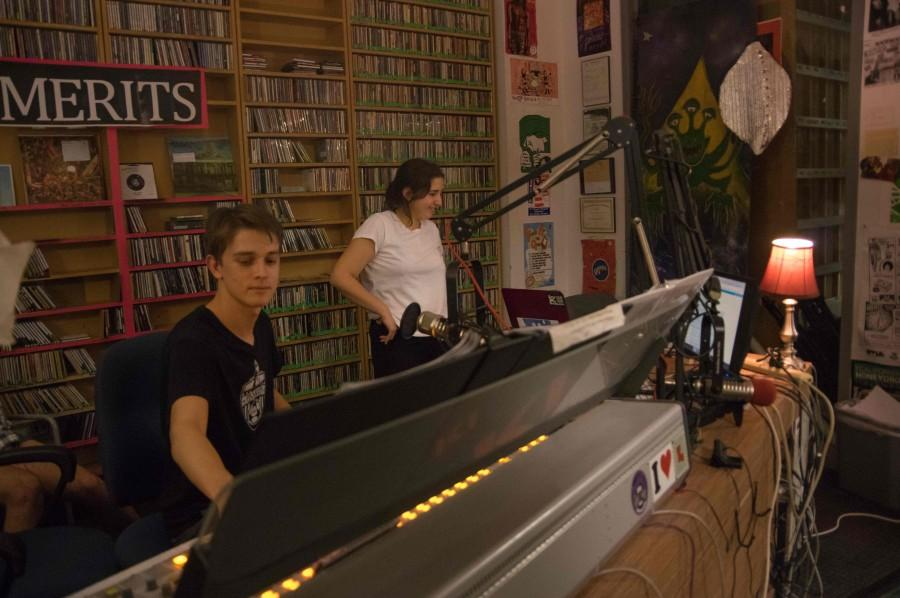 WTUL DJs and students Timothy Dimmock and Daniela Rojas play music on air.