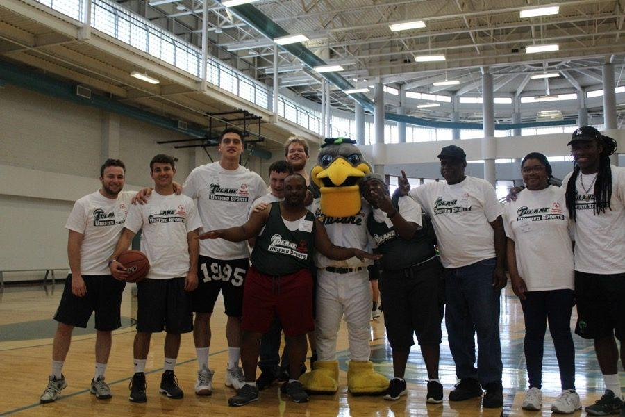 Members of Tulane's football, baseball and men's basketball teams led clinics and drills with participants from the Special Olympics Unified Sports program on the basketball courts of the Reily Center on March 18.