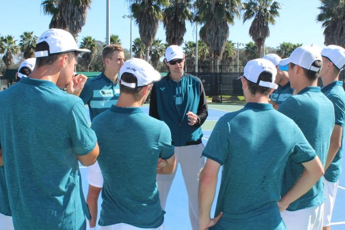 Tulane head men's tennis coach Mark Booras gathers the team before a match. Tennis is off to an 8-2 start on the season and will face off against the University of Pennsylvania on March 10 in New Orleans.