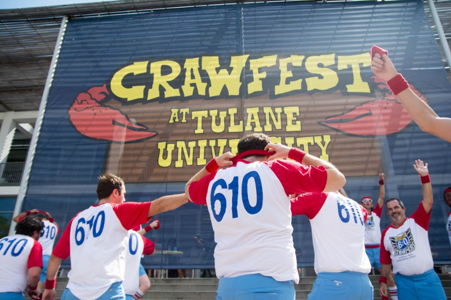610 Stompers prepare to mount the steps of the Lavin-Bernick Center for University Life. They gave an energetic performance for students attending the 11th annual Crawfest.