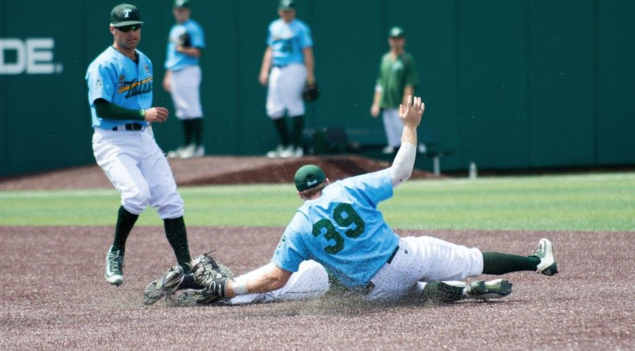 Senior infielder Hunter Williams makes a sliding tag against a Hatters runner when Tulane faced Stetson at Greer Field in Turchin Stadium March 24-26. The Wave ultimately went 1-2 in the Stetson series. Green Wave baseball faced and beat state rival LSU in the thrilling following game 7-6.