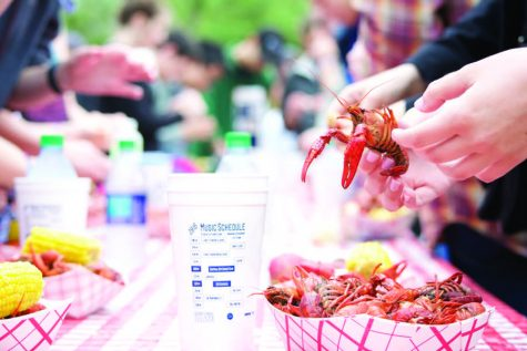 Crawfest 2016 attendees enjoy the event's namesake food. This year marks the 11th Crawfest celebration, offering food, music and family friendly fun Saturday at the Lavin-Bernick Center for University Life and Newcomb Quadrangles.