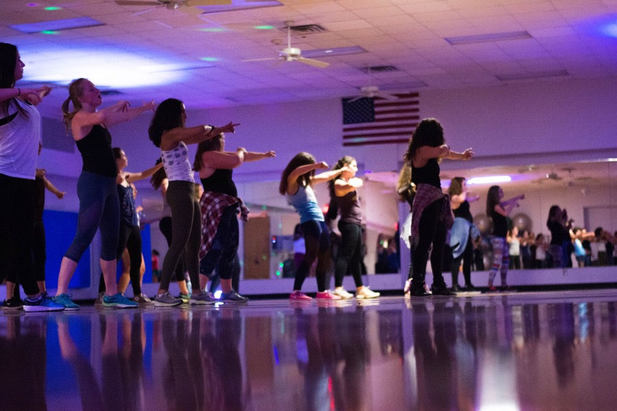 Tulane senior Vanessa Richter leads students in a Vixen Workout session at Reily Student Recreation Center. The class has gained popularity due to its empowering message, encouraging sisterhood through intense hip-hop dance, call-and-response affirmation, and, most importantly, fierceness.
