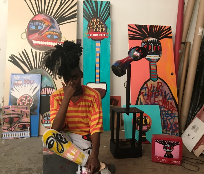 Artist+Gabrielle+Ledet+sits+in+her+home%2C+surrounded+by+her+artwork.+Ledet+is+a+local+New+Orleanian+abstract+artist+who+draws+much+of+her+inspiration+from+her+blackness+and+her+womanhood.+
