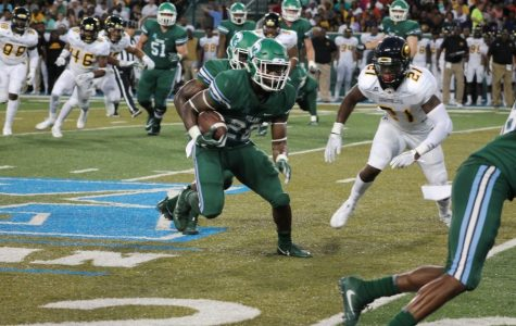 Senior running back Dontrell Hilliard makes a run for the Green Wave at Saturday's game in Yulman Stadium.
