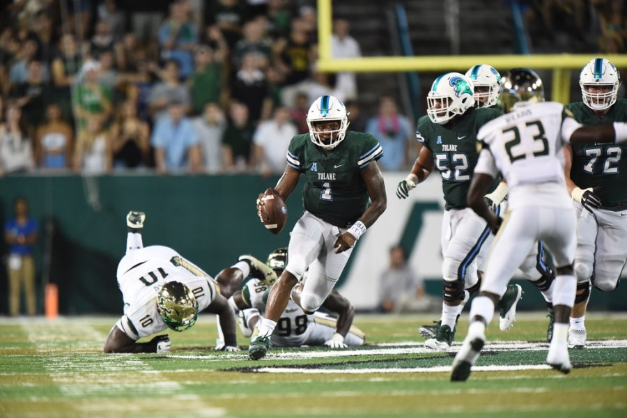Redshirt senior defensive end Ade Aruna runs the ball down the field Saturday against USF in Yulman Stadium.