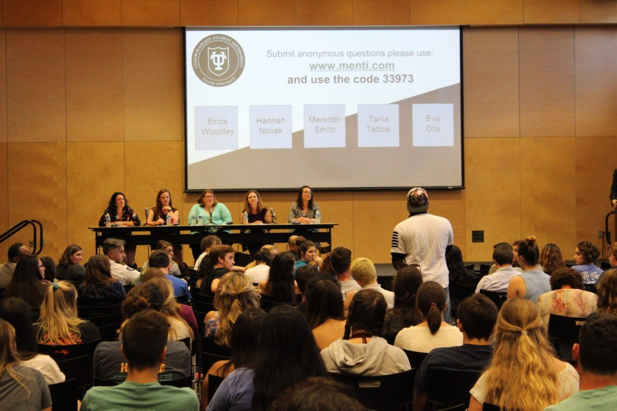 Community+members+gathered+to+ask+a+panel+of+students+and+administrators+questions+about+university-led+efforts+to+combat+sexual+assault+at+a+town+hall+Tuesday+in+Kendall+Cram.+