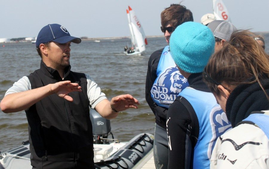 Charles Higgins, recently hired as the head coach for Tulane's sailing team, works with student sailors at his previous institution. Higgins has been sailing since a young age, and worked at Old Dominion for 10 years before getting hired by Tulane Athletics this year.