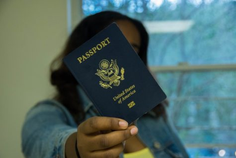 Student Juharah Worku poses with her U.S. passport.