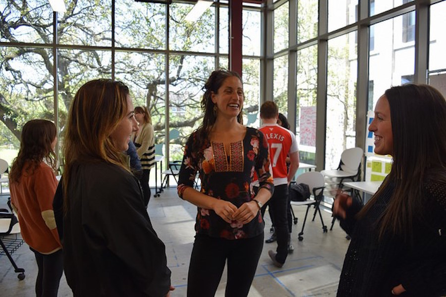 Professor Julia Lang talks with students at The Phyllis M. Taylor Center.