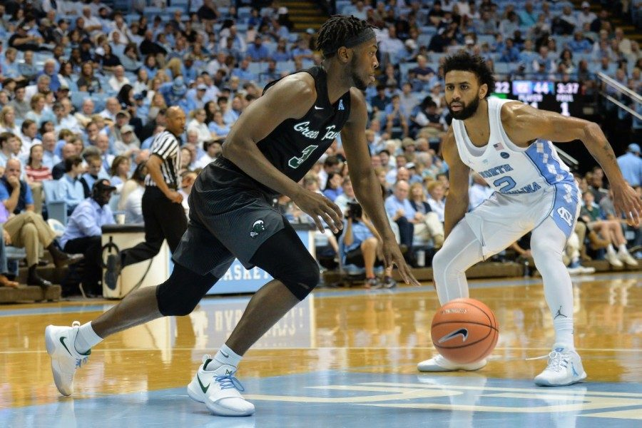 Sophomore+guard+Ray+Ona+Embo+dribbles+down+the+court+Sunday+against+the+University+of+North+Carolina+in+UNC%27s+Chapel+Hill+stadium.+The+Green+Wave+lost+97-73.+