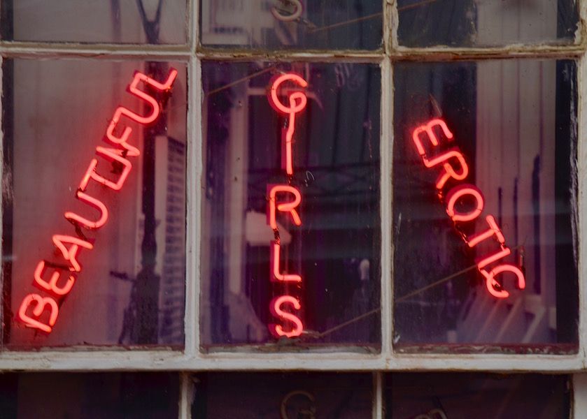 A+shop+on+Bourbon+Street+advertises+strippers+and+professional+dancers.+Establishments+like+these+have+been+linked+to+sex+trafficking+in+the+French+Quarter.