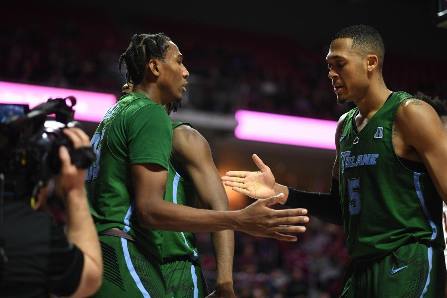 Tulane's Melvin Frazier and Cameron Reynolds give a high five mid-game. Frazier will be hoping for a good selection in this coming year's draft.