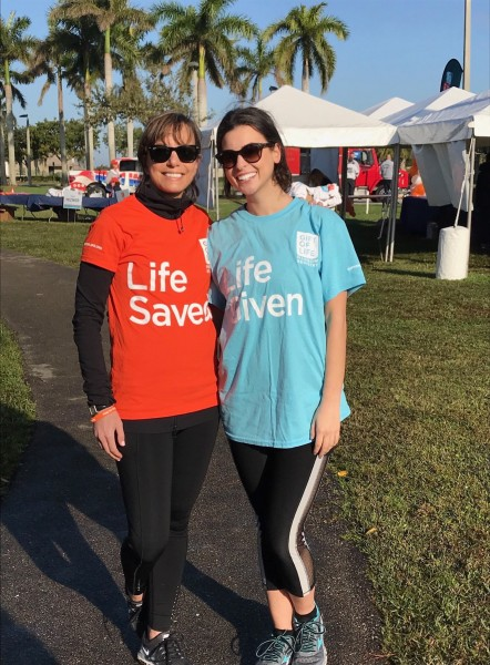 Graduate student Zoe Miller meets stem cell donation recipient at 5k race.